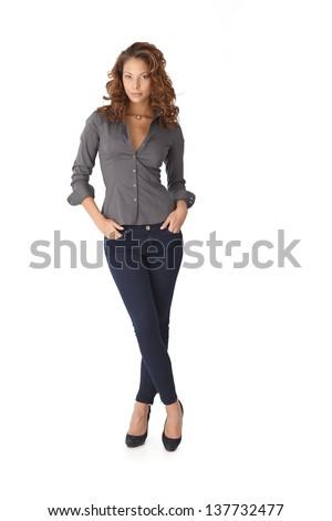 Pretty girl standing legs crossed over white background. Full length. - stock photo