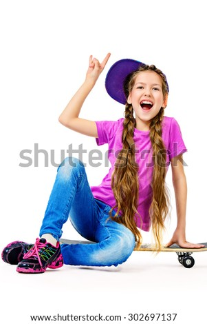 Pretty girl teenager wearing casual clothes posing with her skateboard. Active lifestyle. Studio shot. Isolated over white. - stock photo