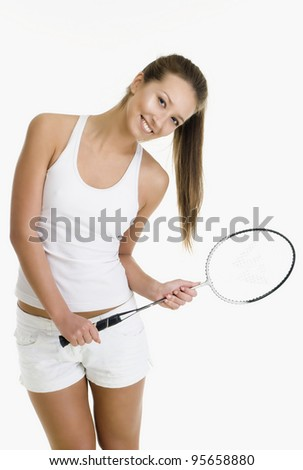 Pretty girl with a badminton racket - stock photo