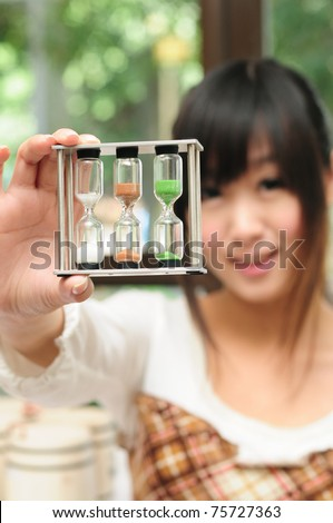 Pretty girl with a hourglass - stock photo