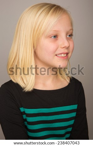 Pretty girl with blond hair - stock photo
