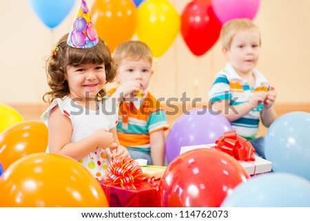 pretty girl  with colorful balloons and gifts on birthday party - stock photo