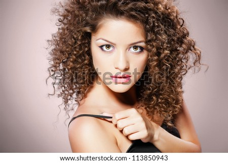 pretty girl with curly hair - stock photo