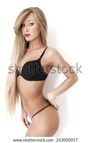 Pretty girl with gorgeous long blond hair posing and looking - stock photo