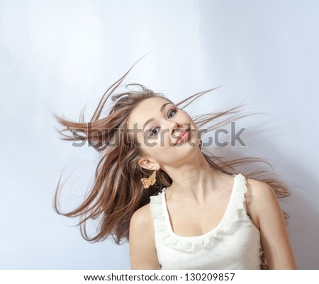 Pretty girl with great fly-away hair. Over white background - stock photo