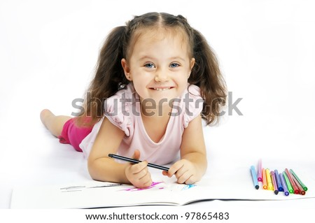 pretty girl with long hair draws markers - stock photo