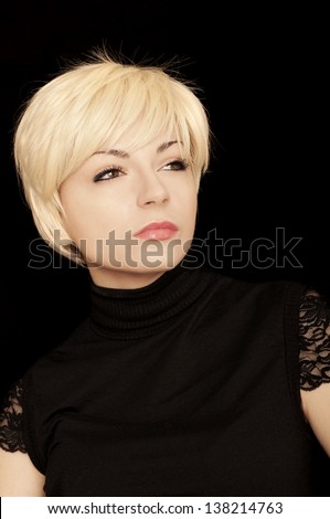 Pretty girl with short blond hair - stock photo