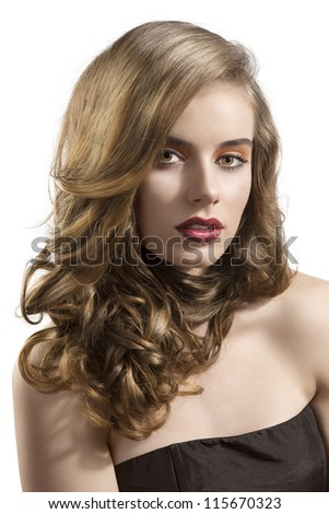 pretty girl with wavy hair and red lipstick, she looks in to the lens with sensual expression - stock photo