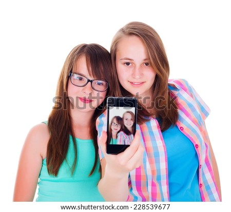 Pretty girlfriends taking a selfie with smartphone - stock photo