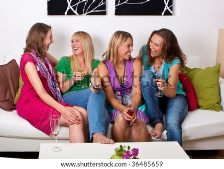 pretty girls looking tv and making a little party - stock photo