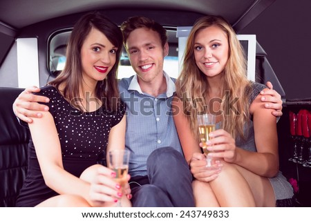 Pretty girls with ladies man in the limousine on a night out - stock photo