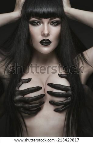 Pretty gothic pale brunette woman - stock photo