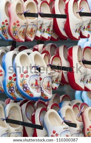 Pretty handmade wooden clogs - stock photo
