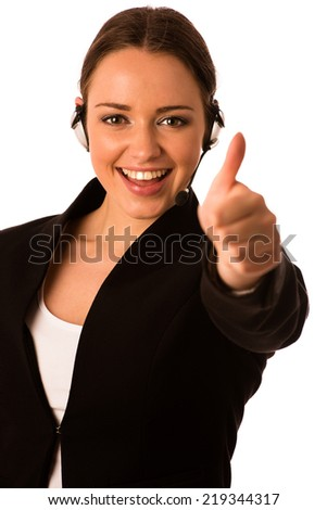 Pretty happy asian caucasian business woman with headset showing thumb up as a gesture for success isolated - stock photo