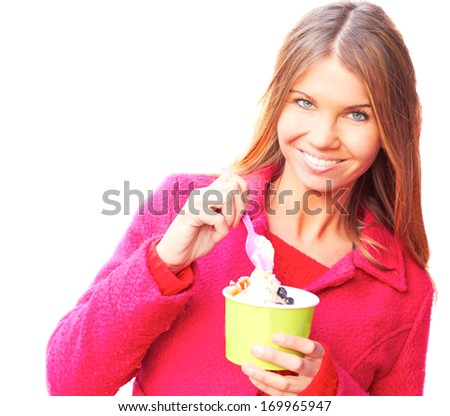 Pretty happy young pretty female eating frozen yogurt. , white background, isolated on white, isolated on white background. - stock photo