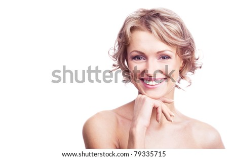 pretty happy young  woman with curly hair, isolated against white, a lot of copy space for your text to the left - stock photo