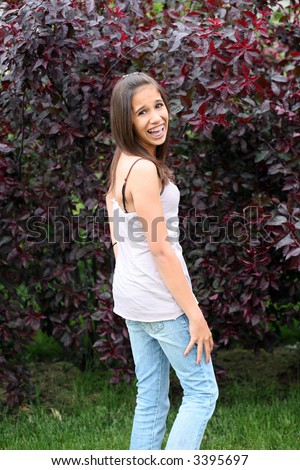 pretty hawaiian preteen with braces laughing - stock photo