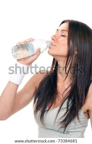Pretty healthy young woman drinking pure mineral bottled water on a white background - stock photo