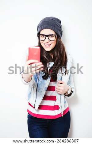 Pretty hipster girl taking a selfie. Let me take a selfie. Instagram - stock photo