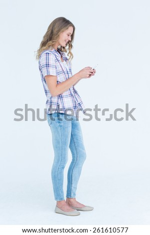Pretty hipster using her smartphone on white background - stock photo