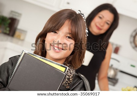 Pretty Hispanic Girl Ready for School with Mom in the Background. - stock photo