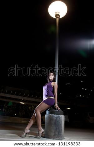 Pretty hispanic woman in party fashion - stock photo
