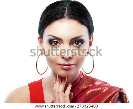 Pretty Indian girl portrait looking at the camera face close up - stock photo