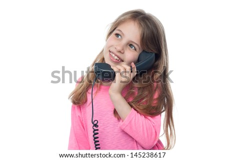 Pretty kid talking on phone. Isolated on white. - stock photo