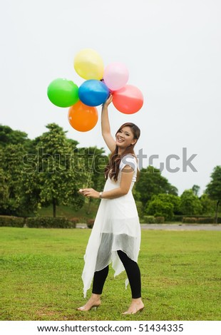 pretty lady playing ballon - stock photo