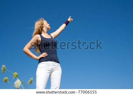 Pretty lady points to the right side - stock photo