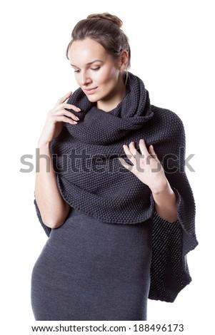 Pretty lady wearing woollen dress with turtleneck - stock photo