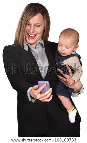 Pretty lady with baby looking at her telephone screen - stock photo