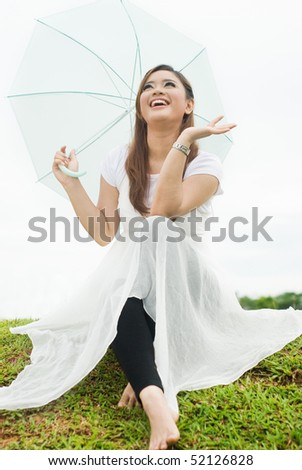 pretty lady with umbrella - stock photo