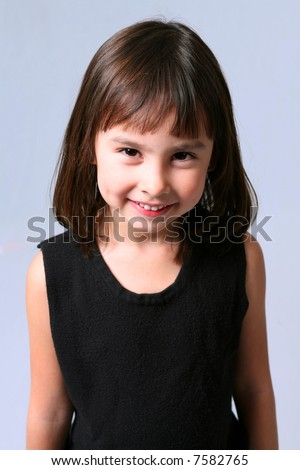 pretty little caucasian brunette girl with dimples smiling - stock photo