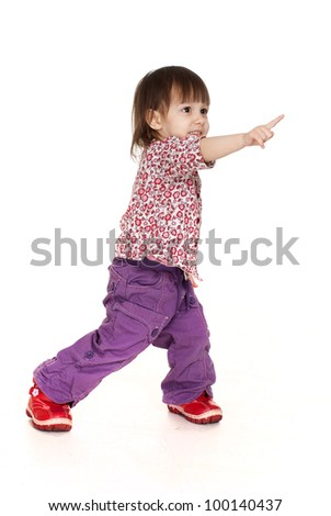 Pretty little Caucasian girl posing on a white background - stock photo