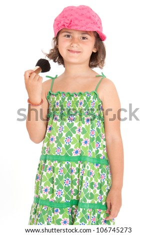 Pretty little girl applying blush with a brush - stock photo