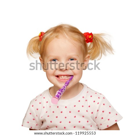 Pretty little girl brushing teeth. Isolated on white background - stock photo