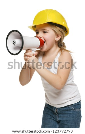 Pretty little girl builder in yellow helmet screaming into the loudspeaker, over white background - stock photo