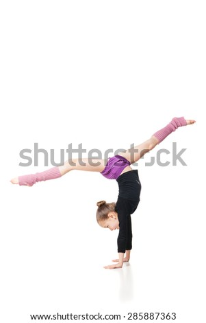pretty little girl doing gymnastics over white background - stock photo