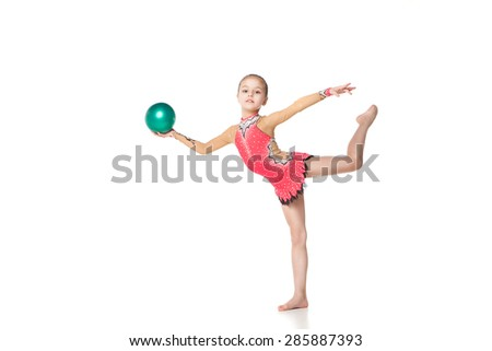 pretty little girl doing gymnastics with a ball over white background - stock photo