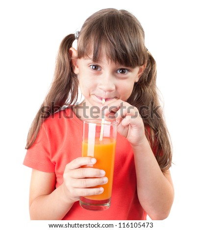 Pretty little girl drinking juice through a straw - stock photo