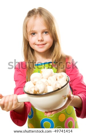 Pretty little girl holding metal pot with mushrooms. Isolated - stock photo