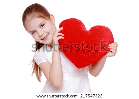 Pretty little girl holding red valentine's heart  - stock photo