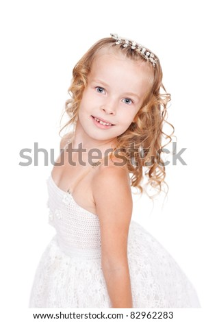 pretty little girl in beautiful white dress isolated on white background - stock photo