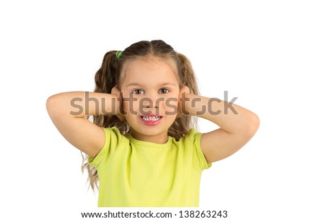 Pretty Little Girl in Green T-Shirt Covering Her Ears, Isolated - stock photo