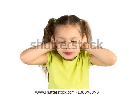 Pretty Little Girl in Green T-Shirt Covering Her Ears with Her Eyes Closed, Isolated - stock photo