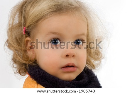 pretty little girl lost in her thoughts - stock photo