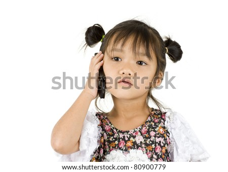 pretty little girl on the phone, isolated on white background - stock photo