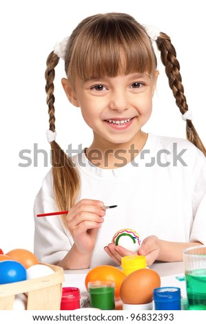 Pretty little girl painting Easter eggs isolated on white background - stock photo