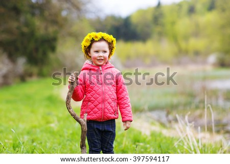 Pretty little girl relax at beauty summer landscape background. Child walking through a forest. Active leisure with kids in nature. - stock photo